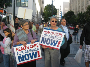 PictureTwo people excitedly fight for healthcare in America.